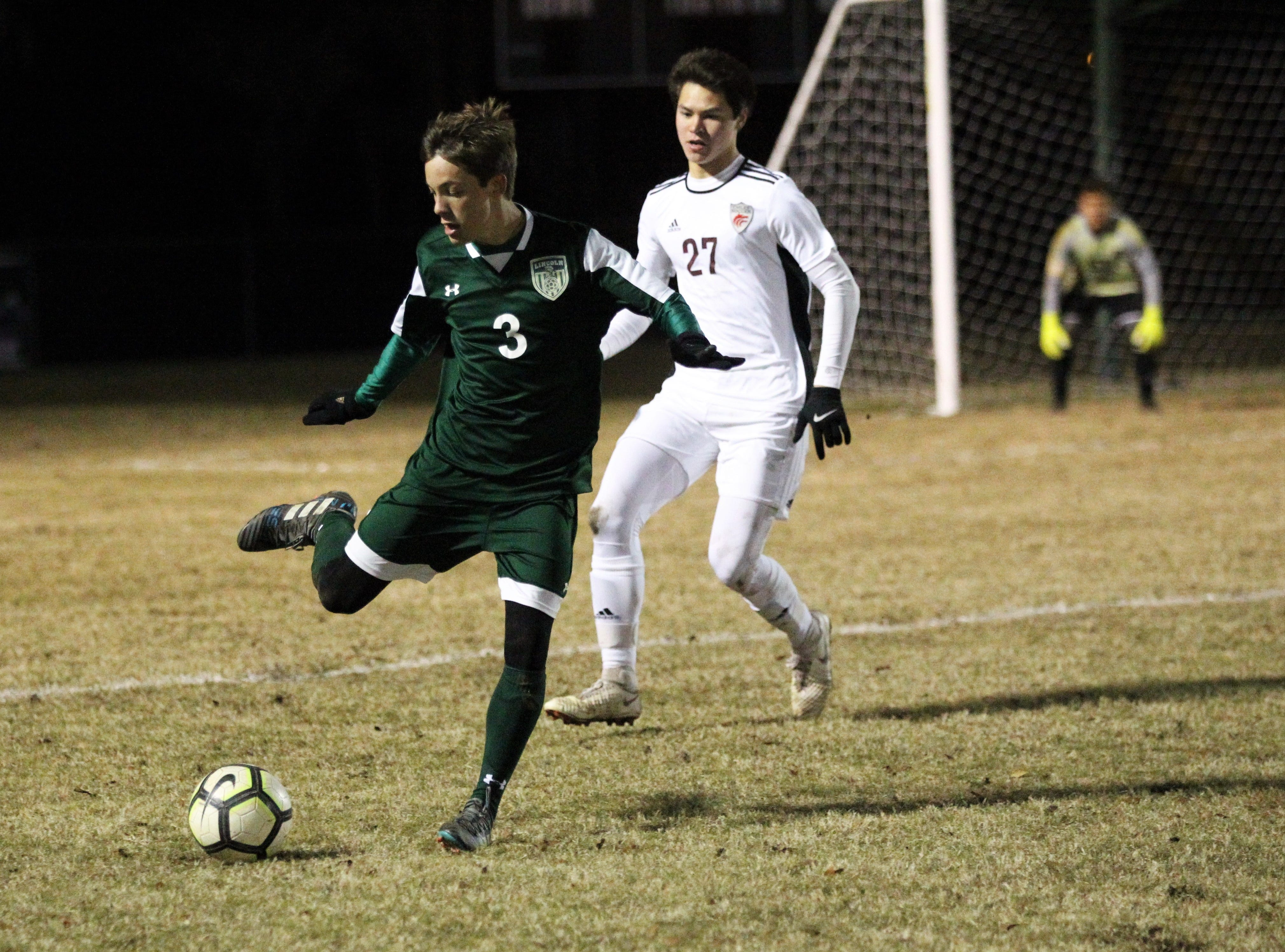 Lincoln's Lukas Reiding makes a pass outside the box as Chiles' boys soccer team beat Lincoln 1-0 in a District 2-4A semifinal on Jan. 30, 2019.