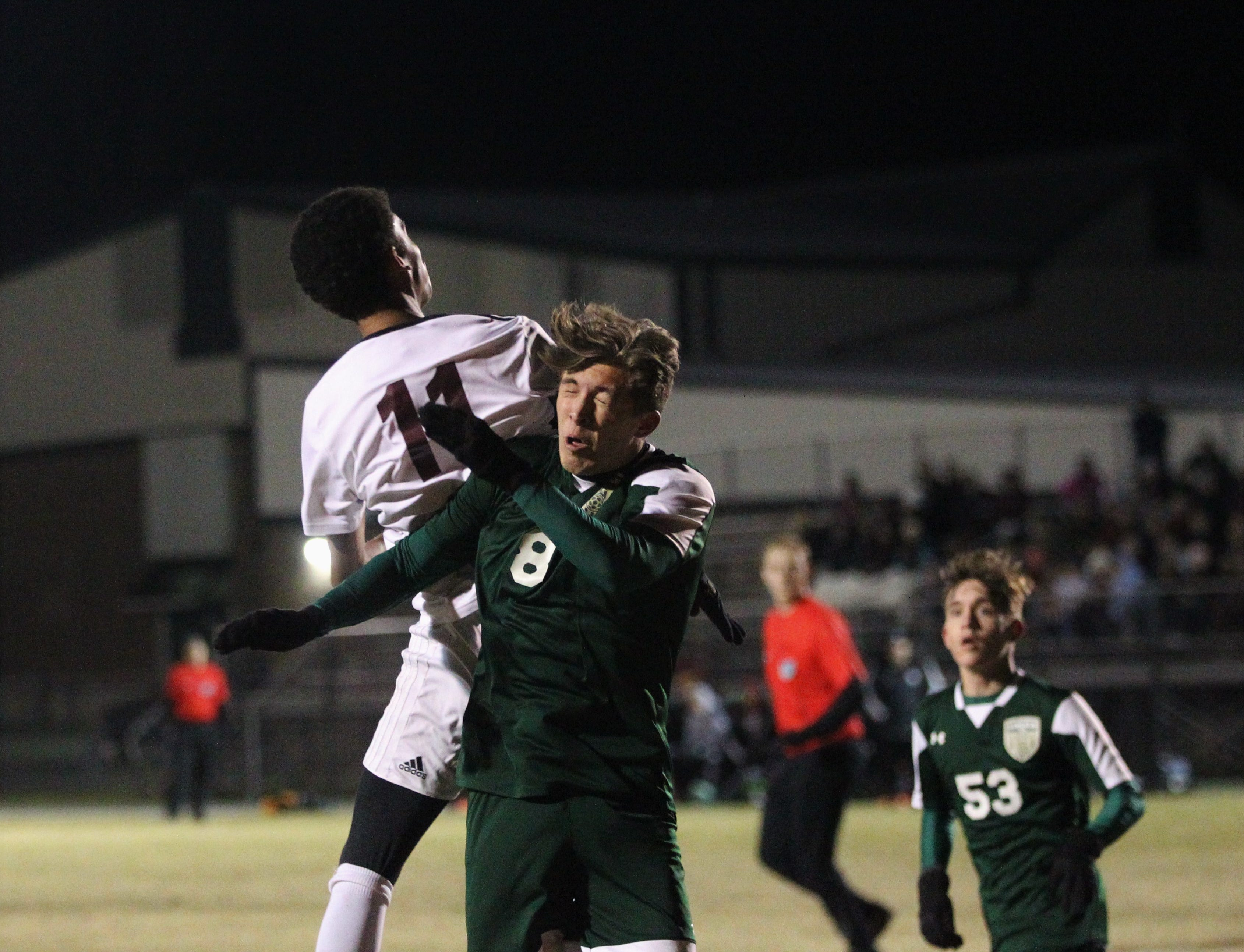 Chiles' Will Johnson gets the upperhand on Lincoln's Nick Molinaro for a 50/50 ball as Chiles' boys soccer team beat Lincoln 1-0 in a District 2-4A semifinal on Jan. 30, 2019.