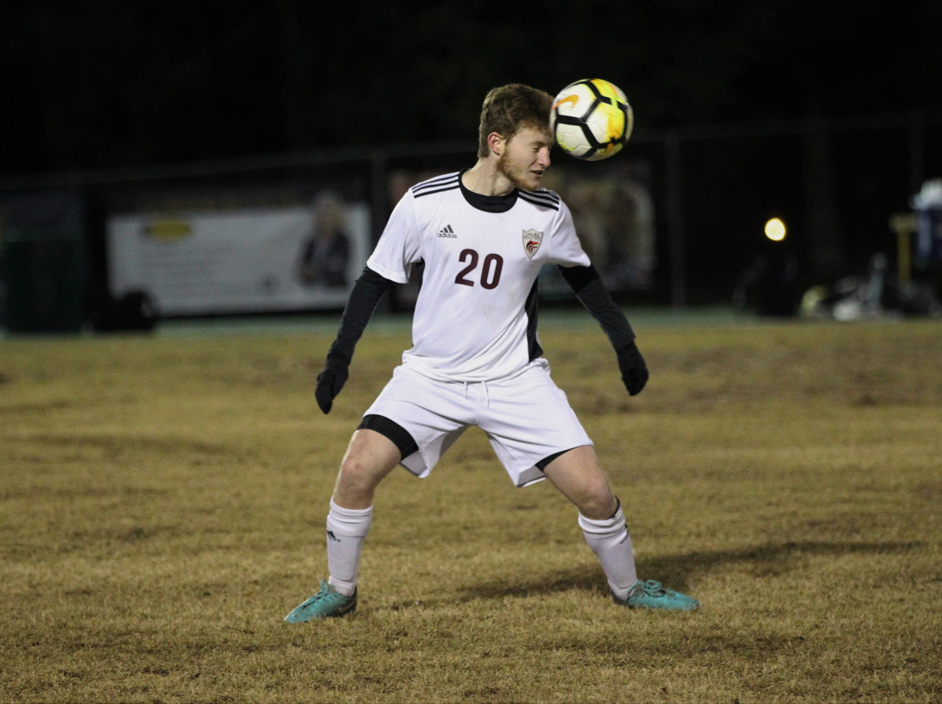 Chiles' Ethan Glogau heads a pass forward as Chiles' boys soccer team beat Lincoln 1-0 in a District 2-4A semifinal on Jan. 30, 2019.