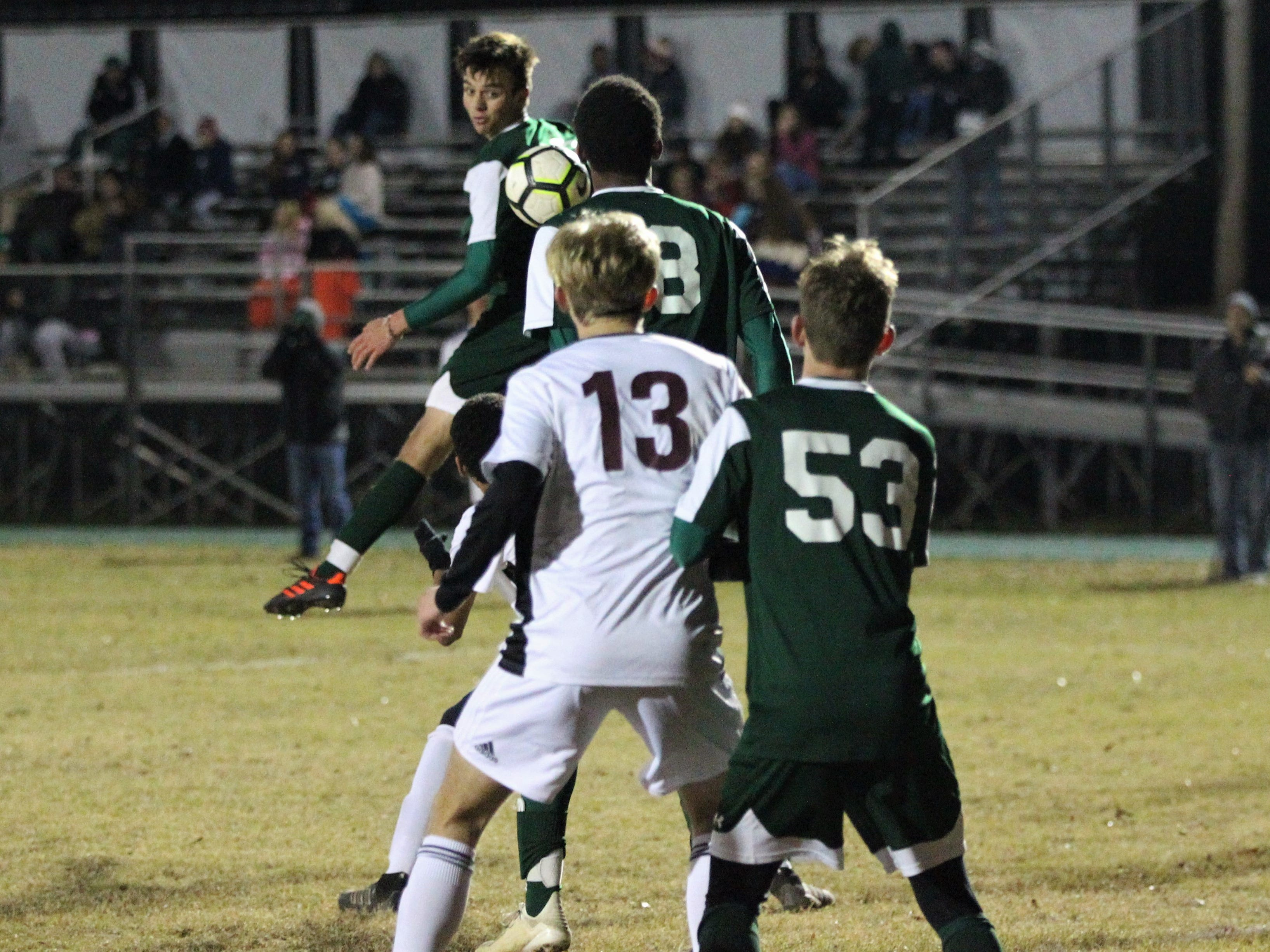 A throw-in from Chiles' Noah Allum heads into the box towards Lincoln's David Monroe, but Chiles' Will Johnson (ducking) poked a header goal as Chiles' boys soccer team beat Lincoln 1-0 in a District 2-4A semifinal on Jan. 30, 2019.
