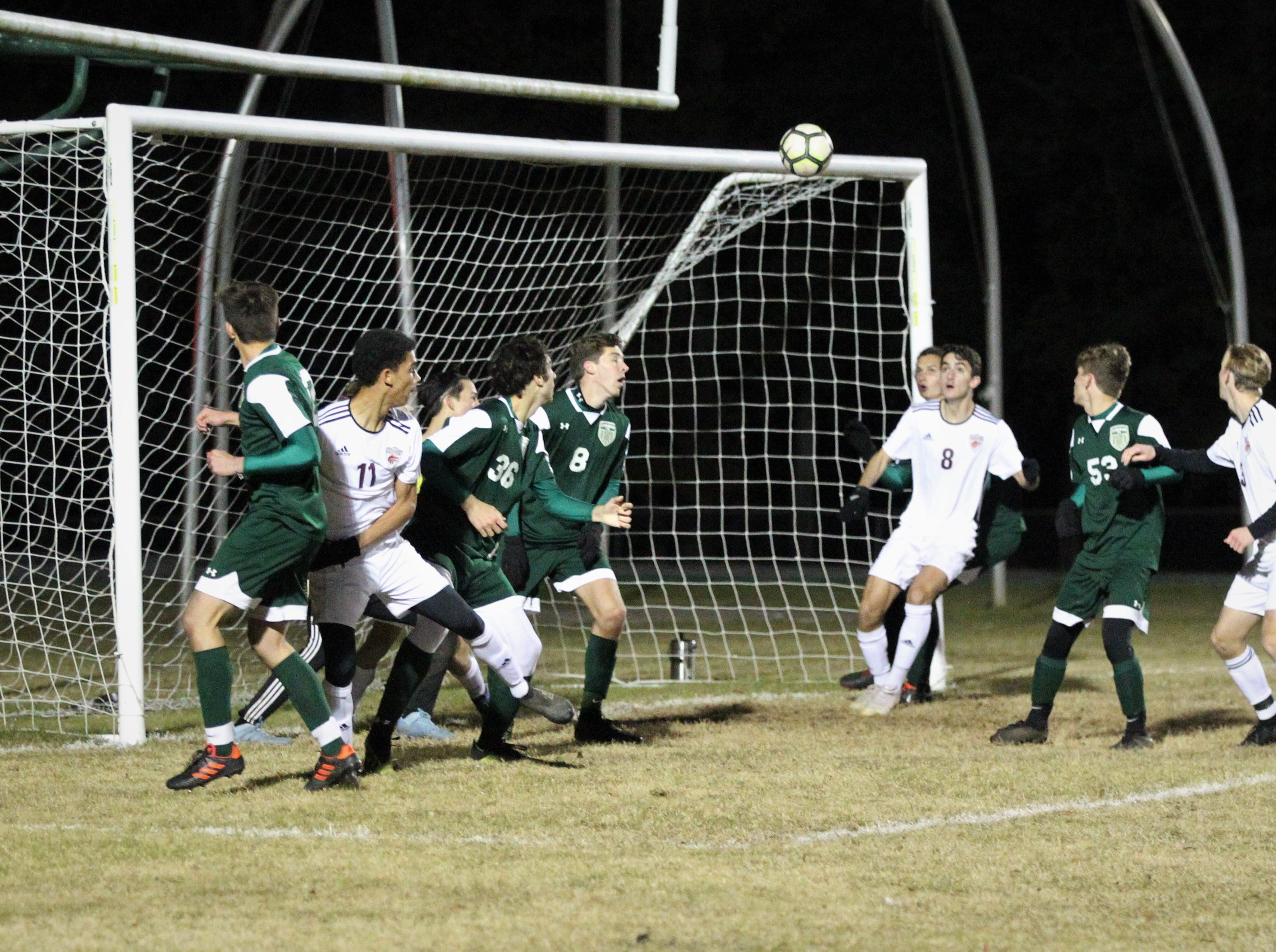 A header flick sails towards Chiles' Tag Lowery but goes over his head as Chiles' boys soccer team beat Lincoln 1-0 in a District 2-4A semifinal on Jan. 30, 2019.