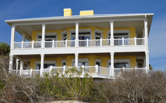 """Chasing the Sun,"" a sunshine yellow beachfront home in the Plantation, has four levels."