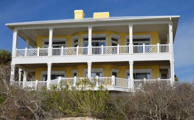 """""""Chasing the Sun,"""" a sunshine yellow beachfront home in the Plantation, has four levels."""