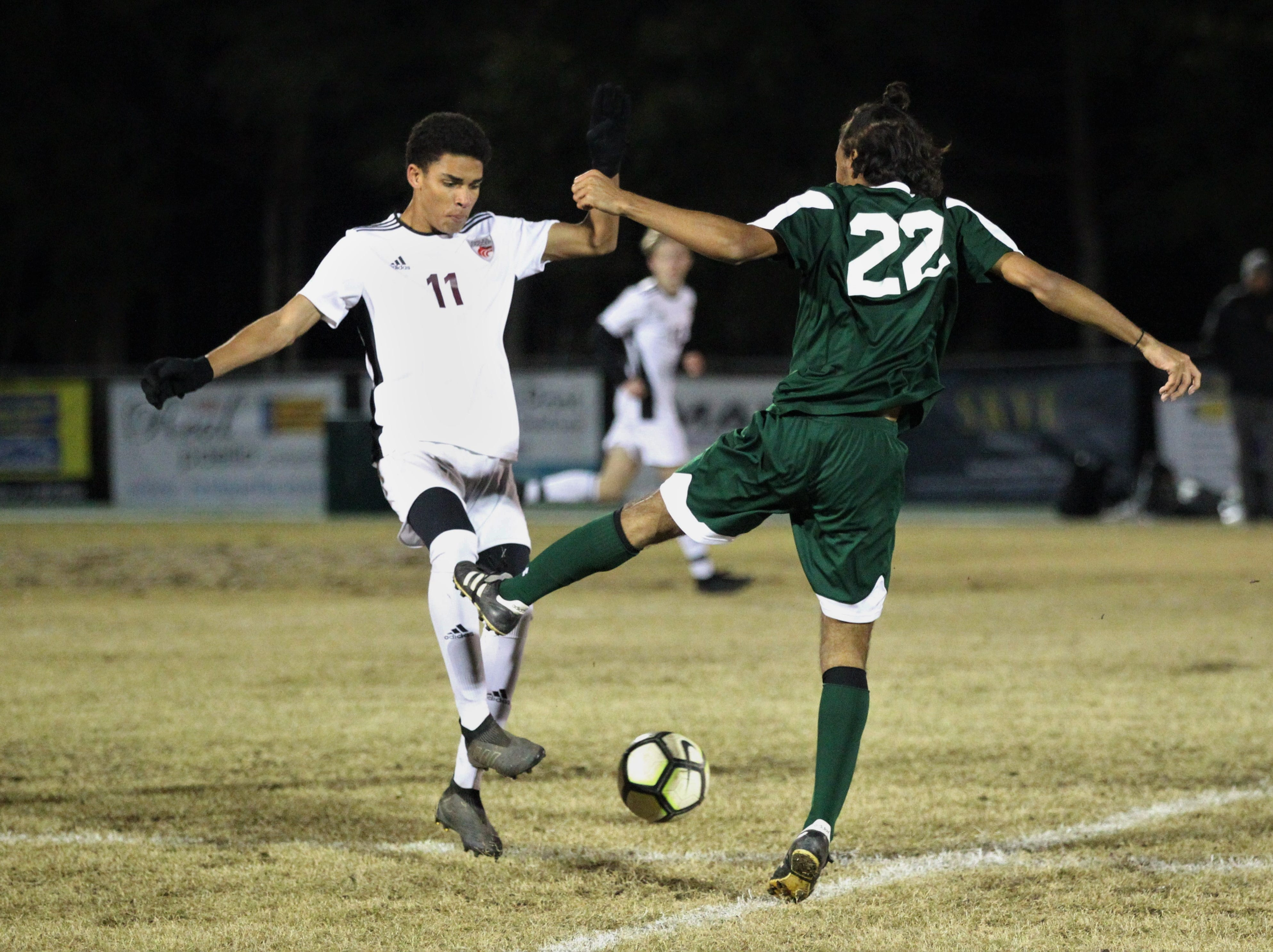 Chiles' Will Johnson and Lincoln's Devon Mays fight for possession as Chiles' boys soccer team beat Lincoln 1-0 in a District 2-4A semifinal on Jan. 30, 2019.