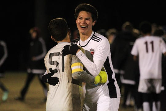 Chiles senior defender Noah Allum hugs keeper Abraheim Darwish after Chiles' boys soccer team beat Lincoln 1-0 in a District 2-4A semifinal on Jan. 30, 2019.