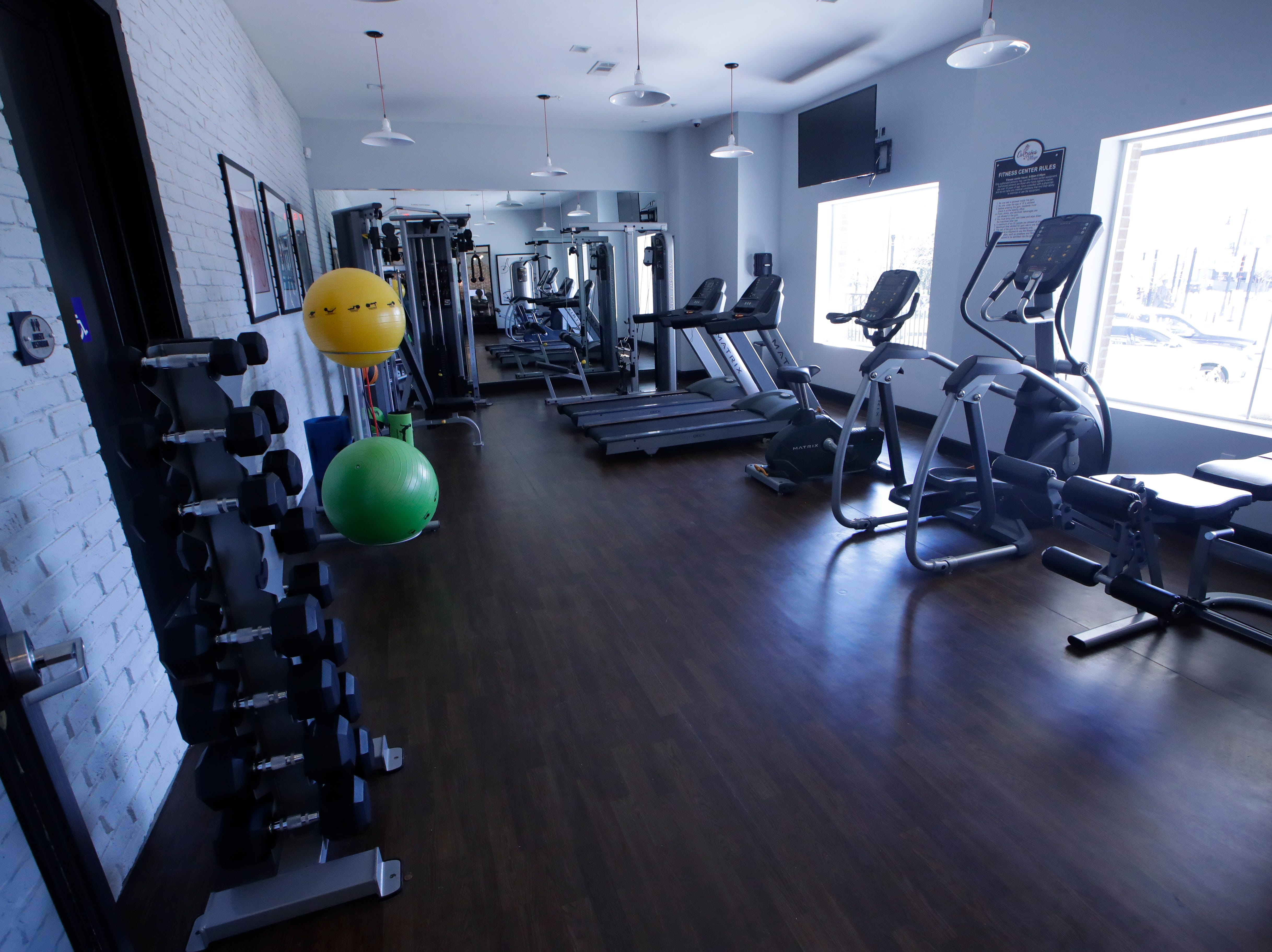 A fitness center is one of the amenities at Casañas Village Apartments at Frenchtown Square.