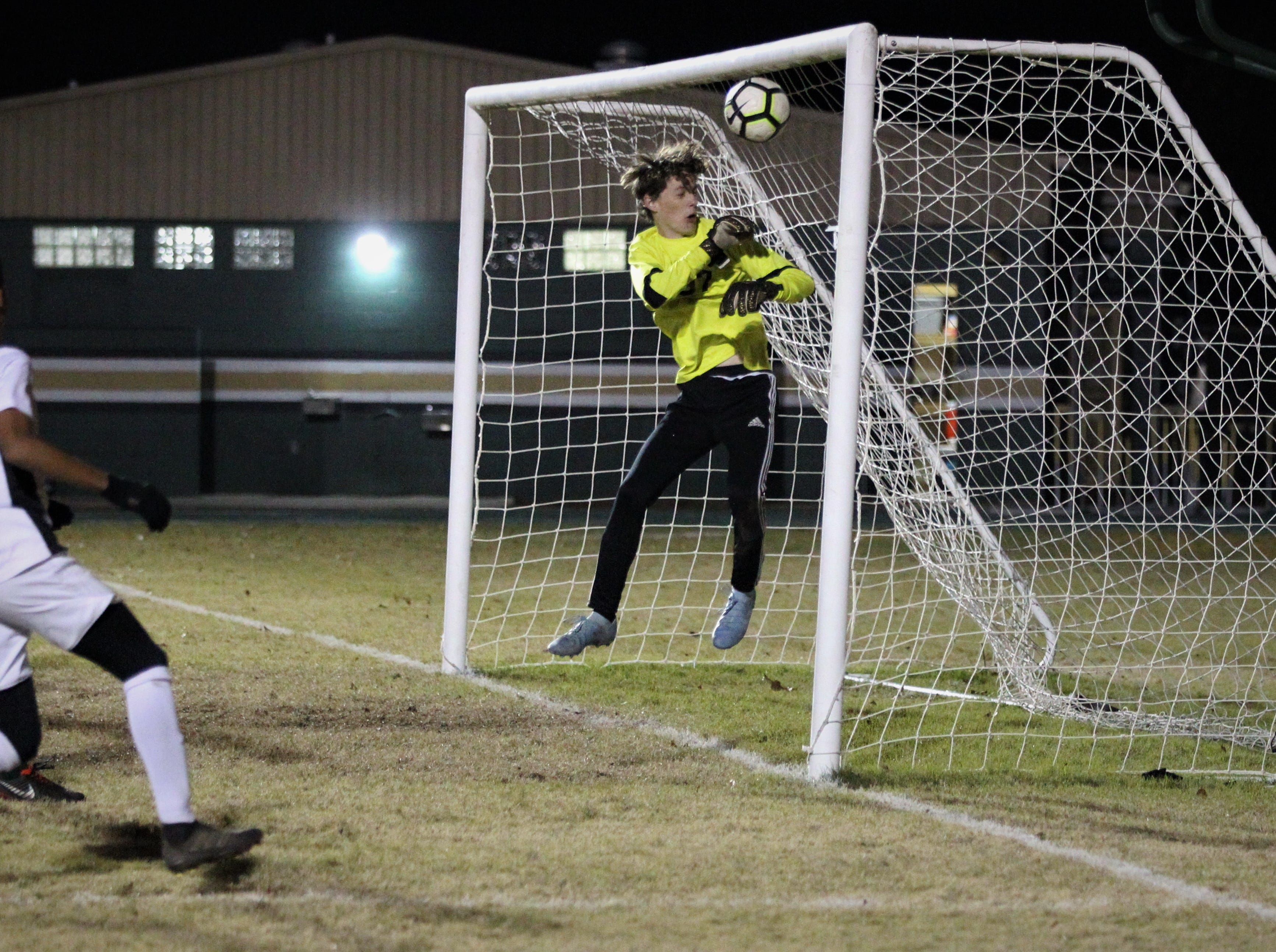Lincoln keeper Aiden Reiding watches as a free kick from Chiles' Patrick O'Sullivan hits the post and bounces out as Chiles' boys soccer team beat Lincoln 1-0 in a District 2-4A semifinal on Jan. 30, 2019.
