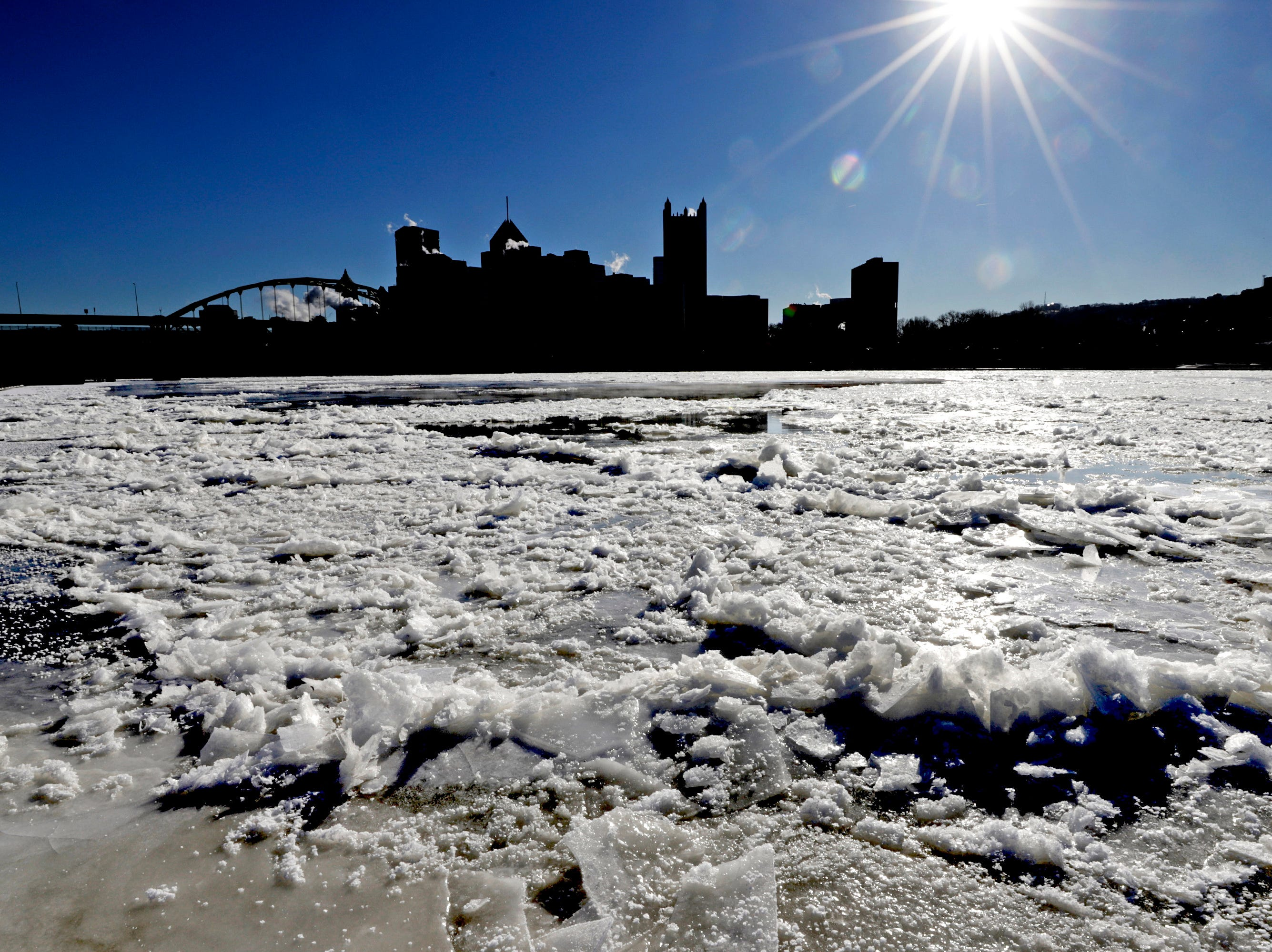 The sun rises over downtown Pittsburgh and a partially frozen Allegheny River on Thursday, Jan 31, 2019. The temperature in Pittsburgh dropped to minus 4 late Wednesday, breaking an 85-year-old record low for Jan. 30 of minus 1 degree.