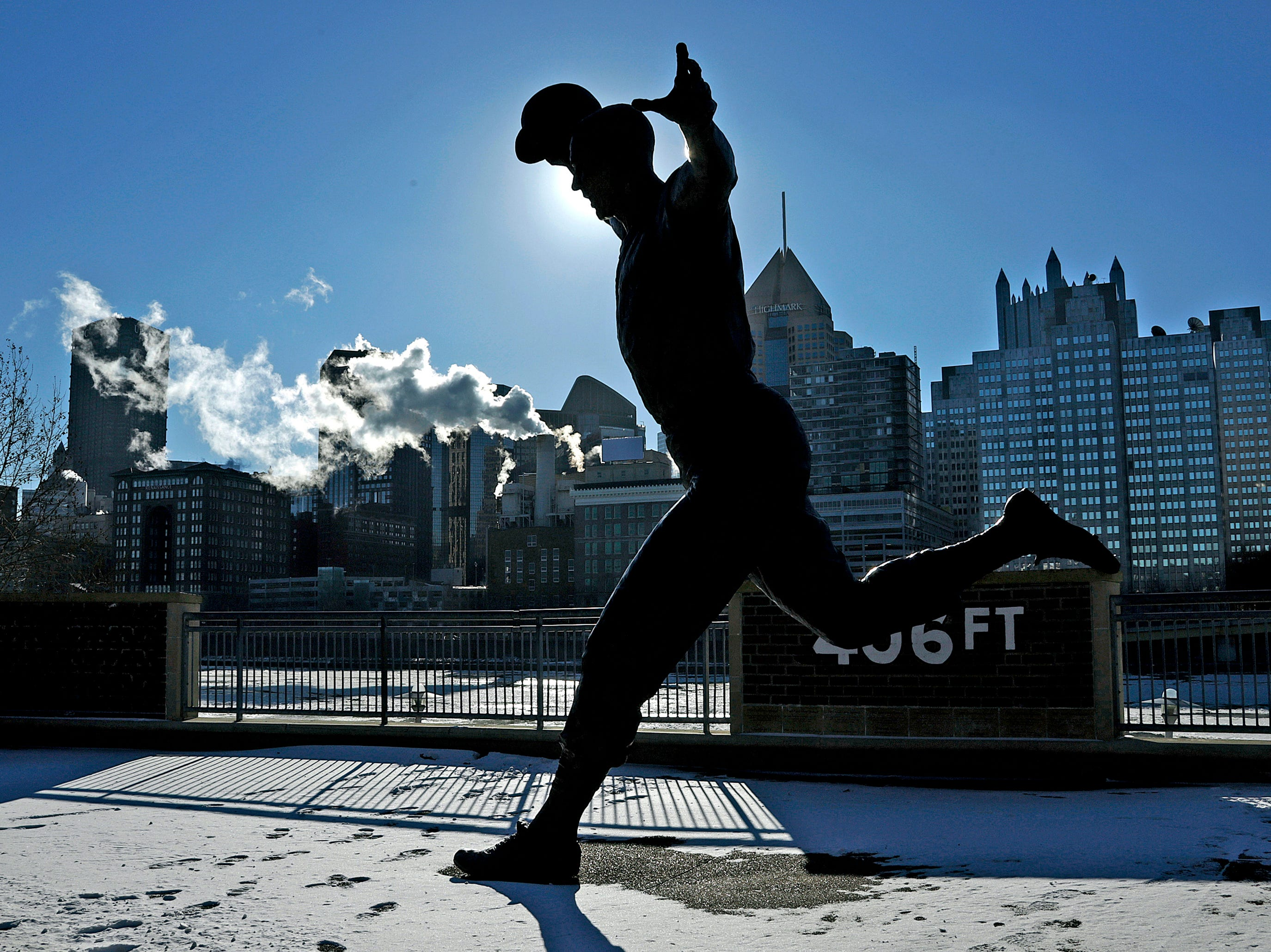 The sunrises over a statue of Pittsburgh Pirates Hall of Famer Bill Mazeroski on the Northside of Pittsburgh on Thursday, Jan 31, 2019. The temperature in Pittsburgh dropped to minus 4 late Wednesday, breaking an 85-year-old record low for Jan. 30 of minus 1 degree.