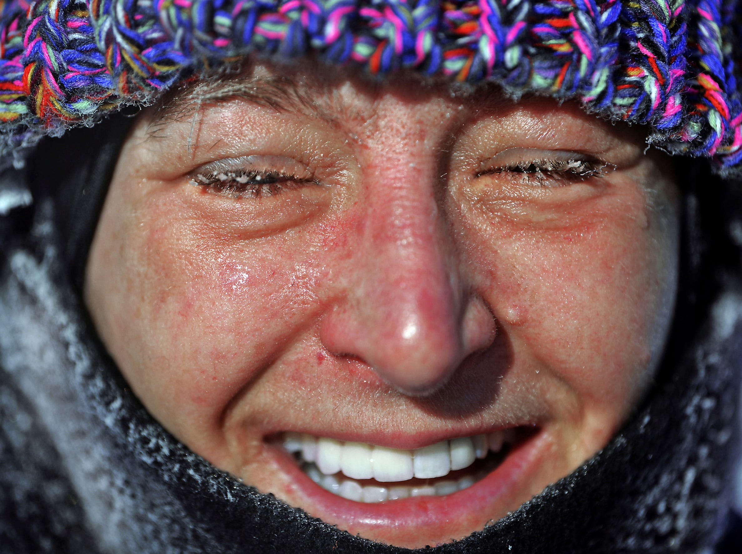 Megan Horeis, 45, of Peckville, Pa., closes her eyes, as tiny pieces of ice form on her eyelashes as she goes for a frigid morning run on Thursday, Jan. 31, 2019, in Dickson City, Pa.