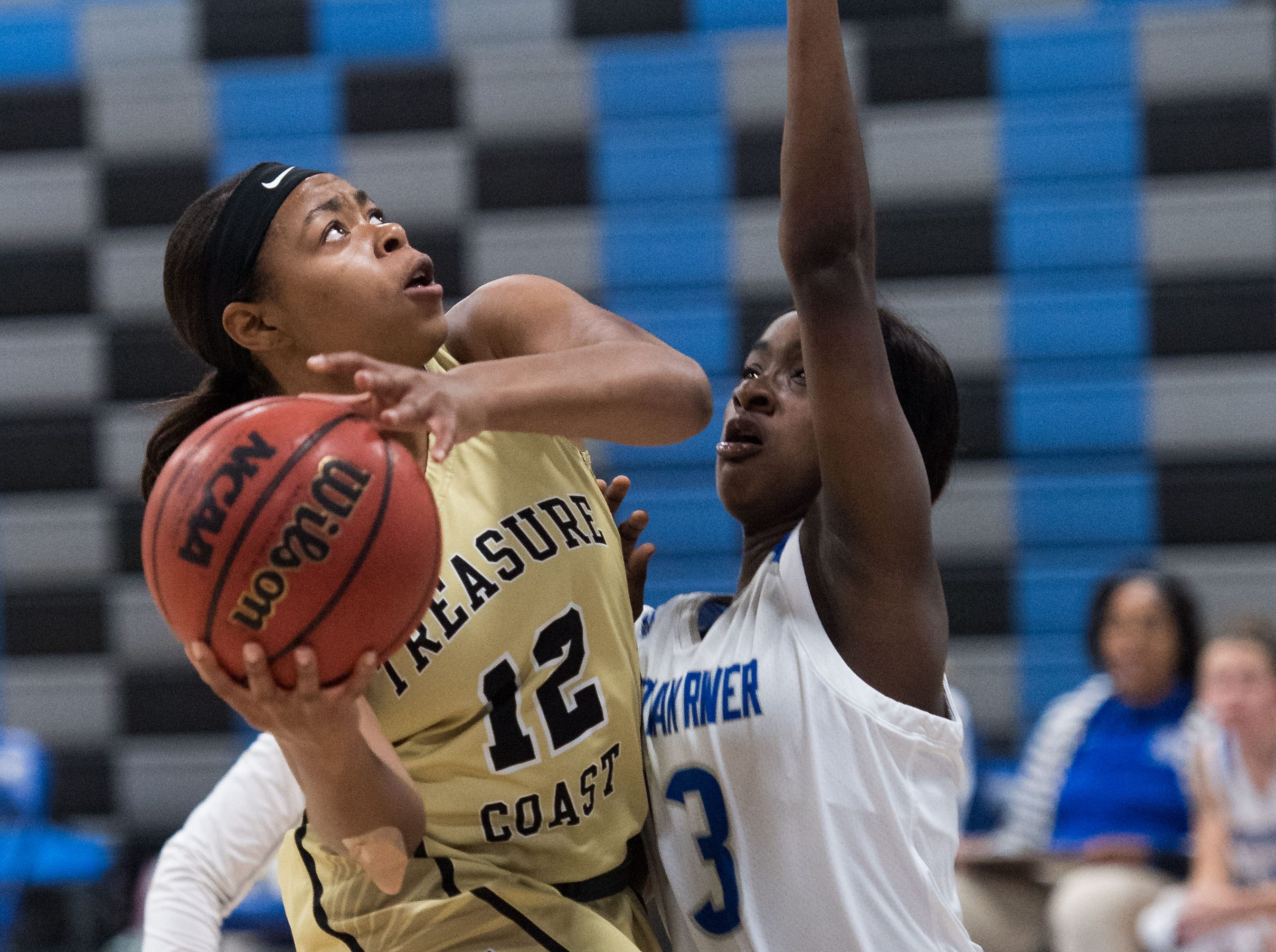 Treasure Coast's Brianna Houston goes up of a shot in the second period as Sebastian River's Tamiyah Wiggins defends during the high school girls basketball game Wednesday, Jan. 30, 2019, at Sebastian River High School.