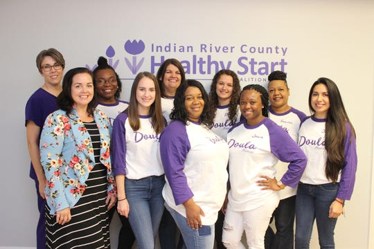 Indian River Healthy Start Coalition CEO Andre Berry, front row, left, with members and graduates of the Community Doula Program in January 2019.