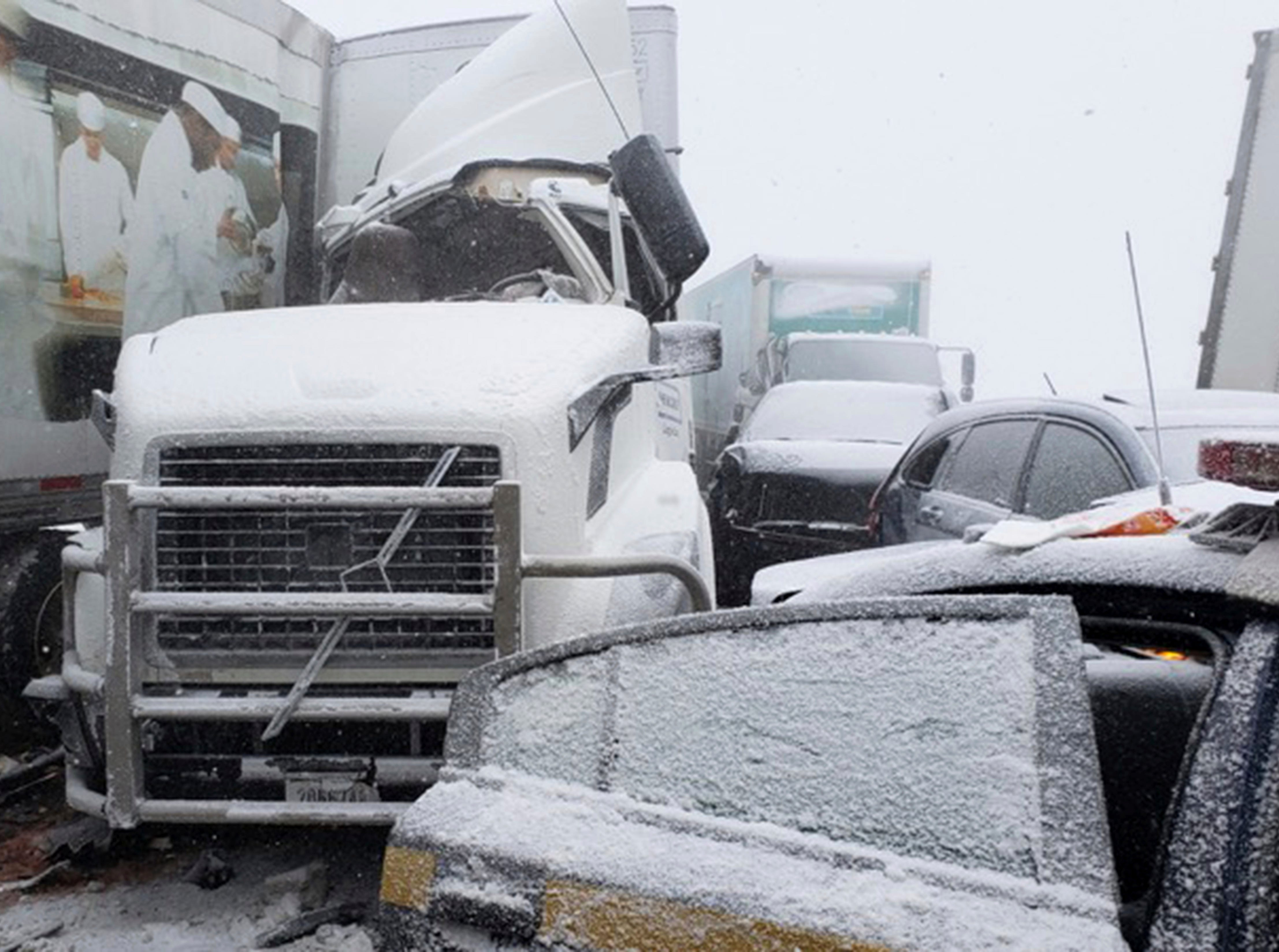 In this Wednesday, Jan. 30, 2019 photo, cars and trucks are part of a 21 vehicle pileup in Batavia, N.Y. Police say the crash shut down the New York State Thruway where heavy snow and high winds made driving treacherous.