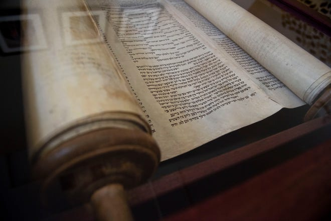 """A Holocaust-era Torah scroll, seen Thursday, Jan. 31, 2019, at Temple Beit HaYam in Stuart, will be debuted in a new display at a special Shabbat evening service Feb. 15 at 7:30 p.m. The Torah scroll has been at the temple since the 1990s, but Rabbi Matt Durbin wanted it to be more visible. A core group of the temple's community raised money for the custom-made case so it would be on display. """"It's quite humbling,"""" Durbin said of the scroll. """"The intent is that (the temple congregation will) see it and connect with it and some way."""""""