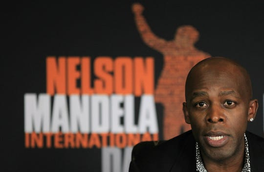 """In this July 10, 2013, file photo, U.S. singer Joe Thomas, known as Joe, is shown during a news conference in honor of Mandela Day at the Nelson Mandela Centre of Memory in Johannesburg, South Africa. For Grammy-nominated singer Joe, singing the hit song embattled singer R. Kelly wrote and produced for him is out of the question. """"I've stopped performing the song,"""" he said in a statement to The Associated Press, referring to """"More & More,"""" a Top 20 R&B success released in 2003."""