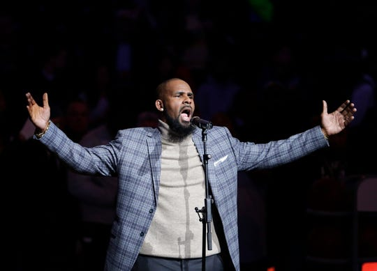 In this Nov. 17, 2015, file photo, musical artist R. Kelly performs the national anthem before an NBA basketball game between the Brooklyn Nets and the Atlanta Hawks in New York.  For Grammy-nominated singer Joe, singing the hit song R. Kelly wrote and produced for him is out of the question.