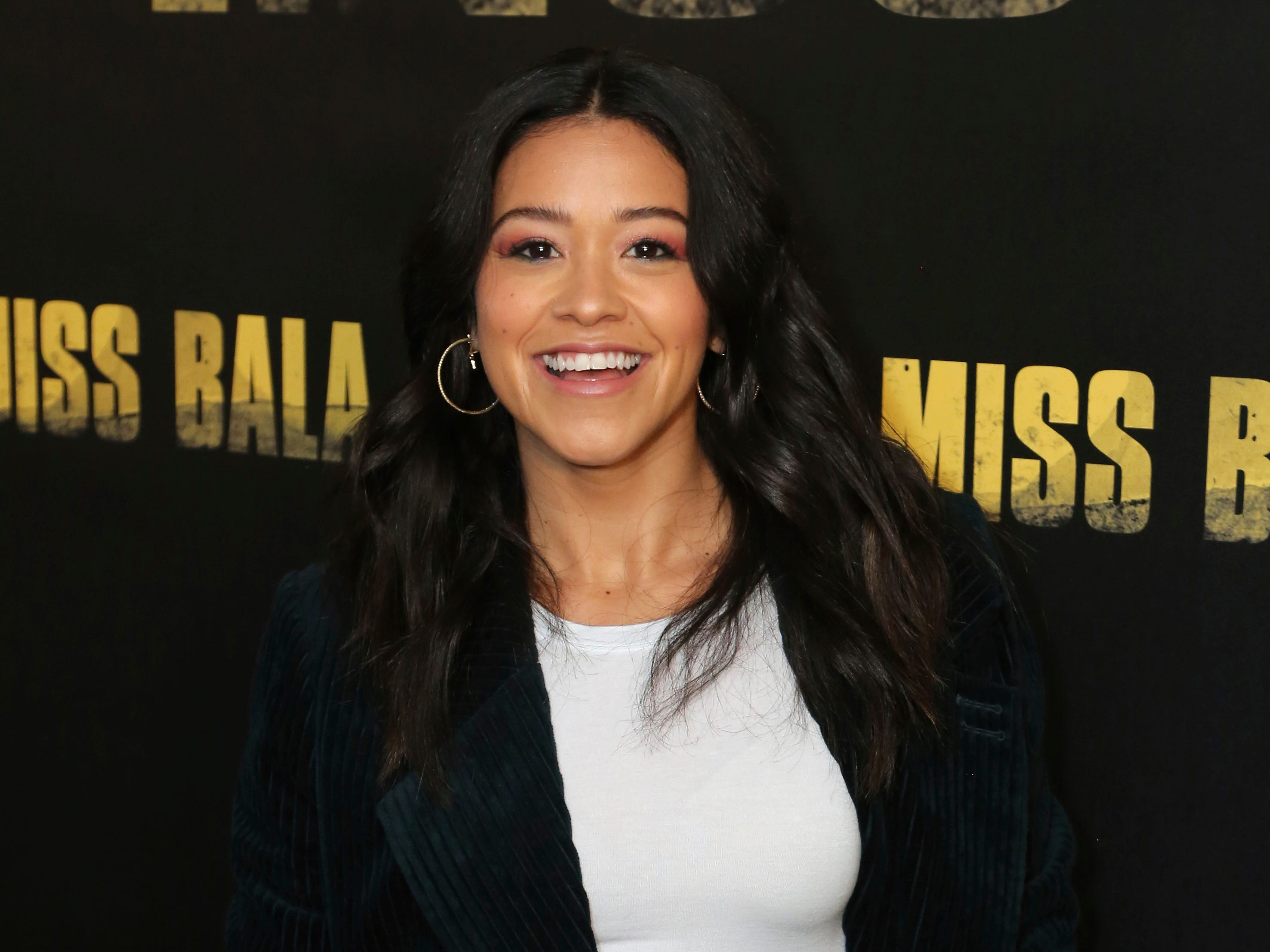 """Gina Rodriguez poses for a photo at the """"Miss Bala"""" Photo Call at The London West Hollywood on Sunday, Jan. 13, 2019, in West Hollywood, Calif."""