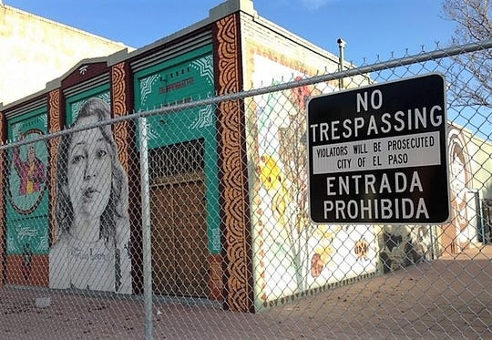 Much of the Duranguito neighborhood was fenced in by the city in late 2018 to prepare for demolition of the buildings, which has been halted by a legal battle. A green canvas now covers the fencing, making the buildings less visible.