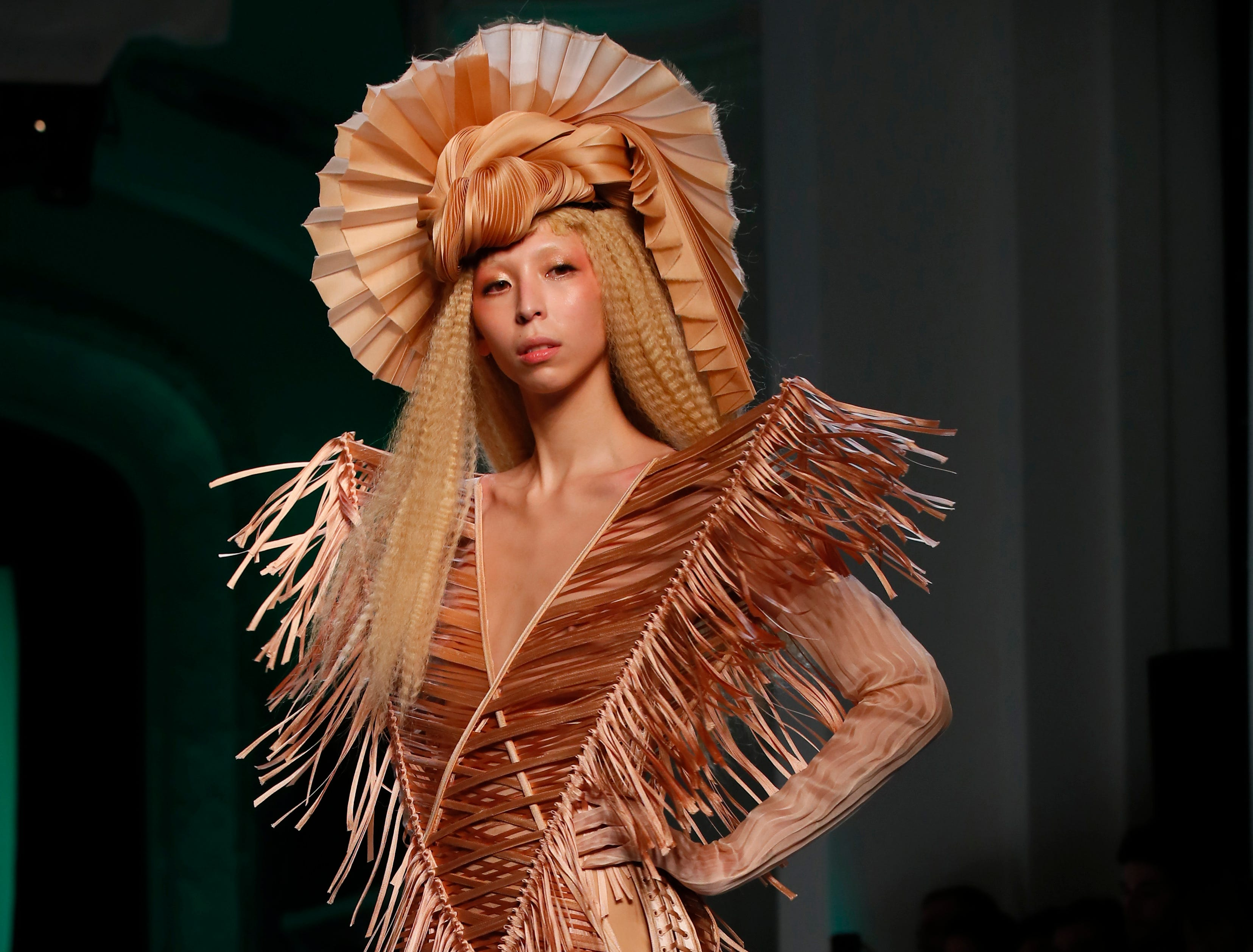 A model wears a creation for Jean-Paul Gaultier's Spring/Summer 2019 Haute Couture fashion collection presented in Paris, Wednesday Jan.23, 2019.
