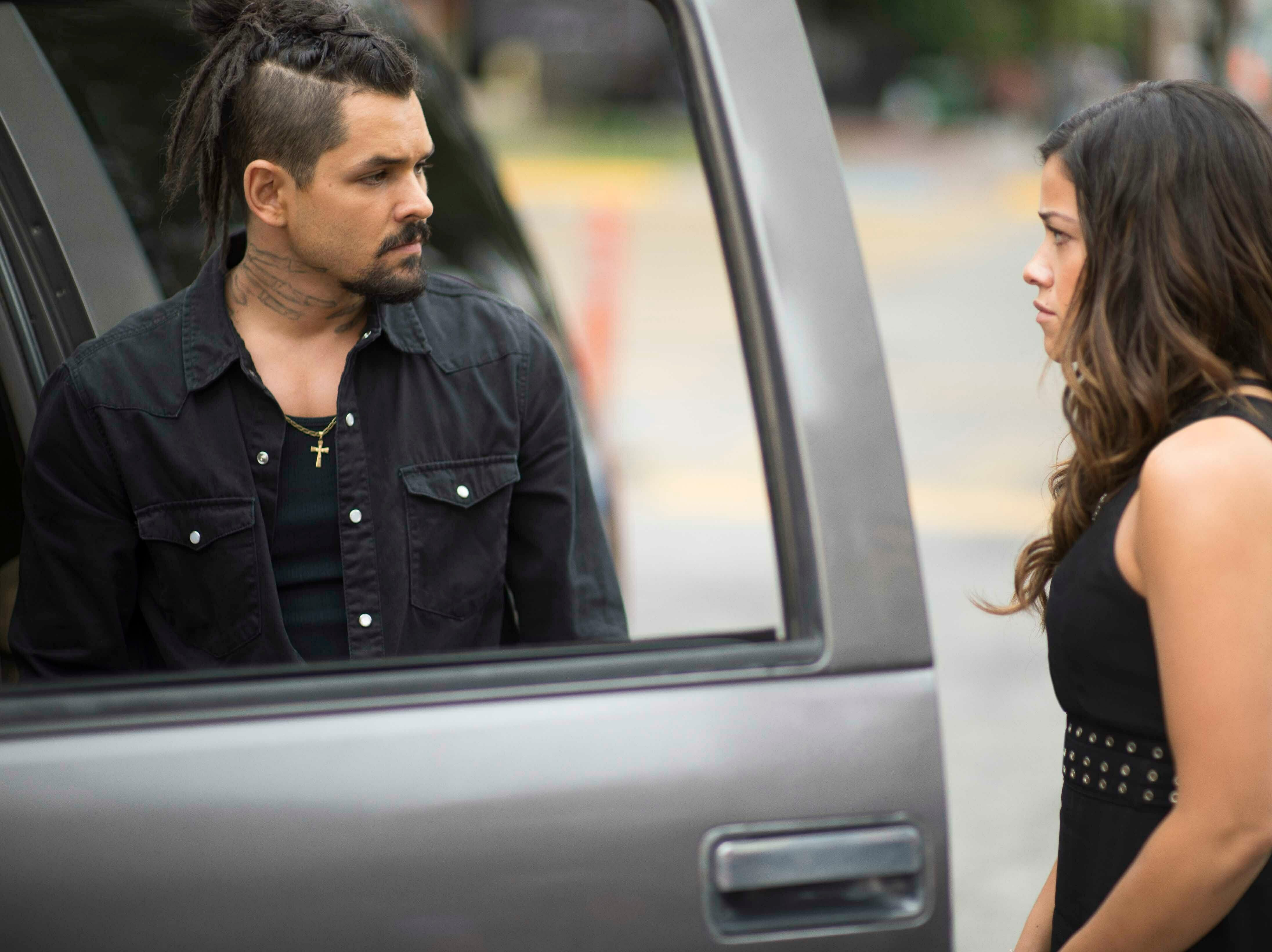 """This image released by Sony Pictures shows Ricardo Abarca, left, and Gina Rodriguez in a scene from """"Miss Bala."""""""