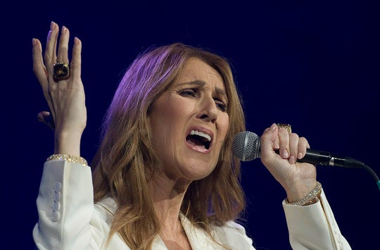 """In this July 31, 2016, file photo, Celine Dion performs in concert at the Bell Centre in Montreal. Dion followed in Lady Gaga's footsteps, removing her Grammy-nominated duet with embattled singer R. Kelly, """"I'm Your Angel,"""" from streaming platforms."""