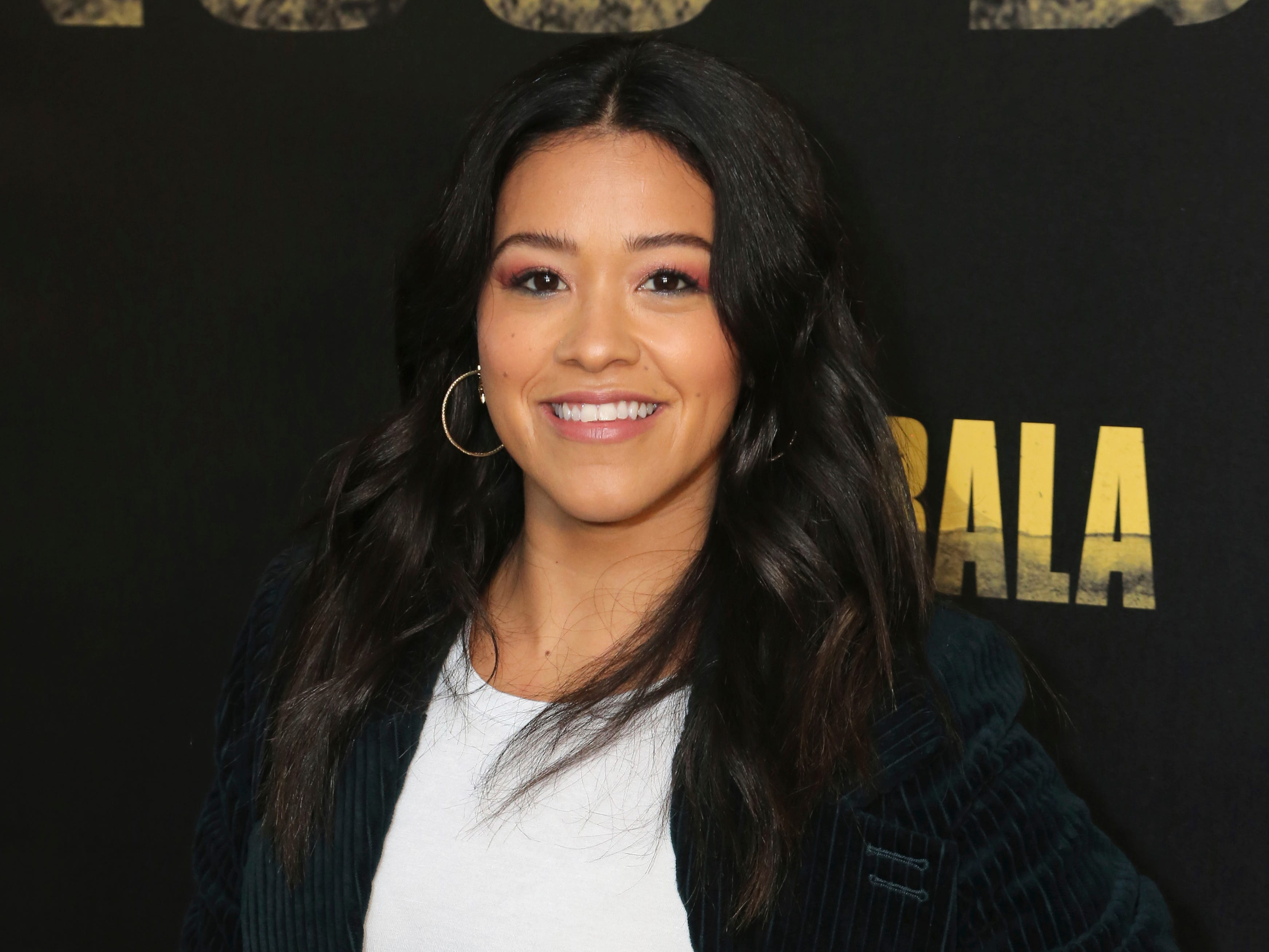 """Gina Rodriguez poses for a photo at the """"Miss Bala"""" Photo Call at The London West Hollywood on Sunday, Jan. 13, 2019 in West Hollywood, Calif."""
