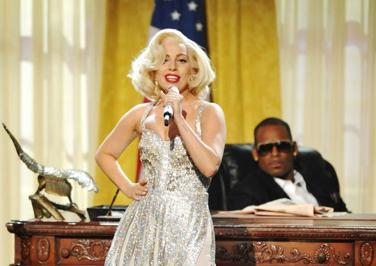 """In this Nov. 24, 2013, file photo, Lady Gaga and R. Kelly perform """"Do What U Want (With My Body)"""" at the American Music Awards in Los Angeles. In the wake of multiple allegations against R. Kelly, which hit a new height in January 2019 with the release of the Lifetime documentary series """"Surviving R. Kelly,"""" some performers are denouncing songs the R&B hit-maker created with them. Lady Gaga apologized for her 2013 duet with R. Kelly, """"Do What U Want"""" and removed the track from streaming services."""