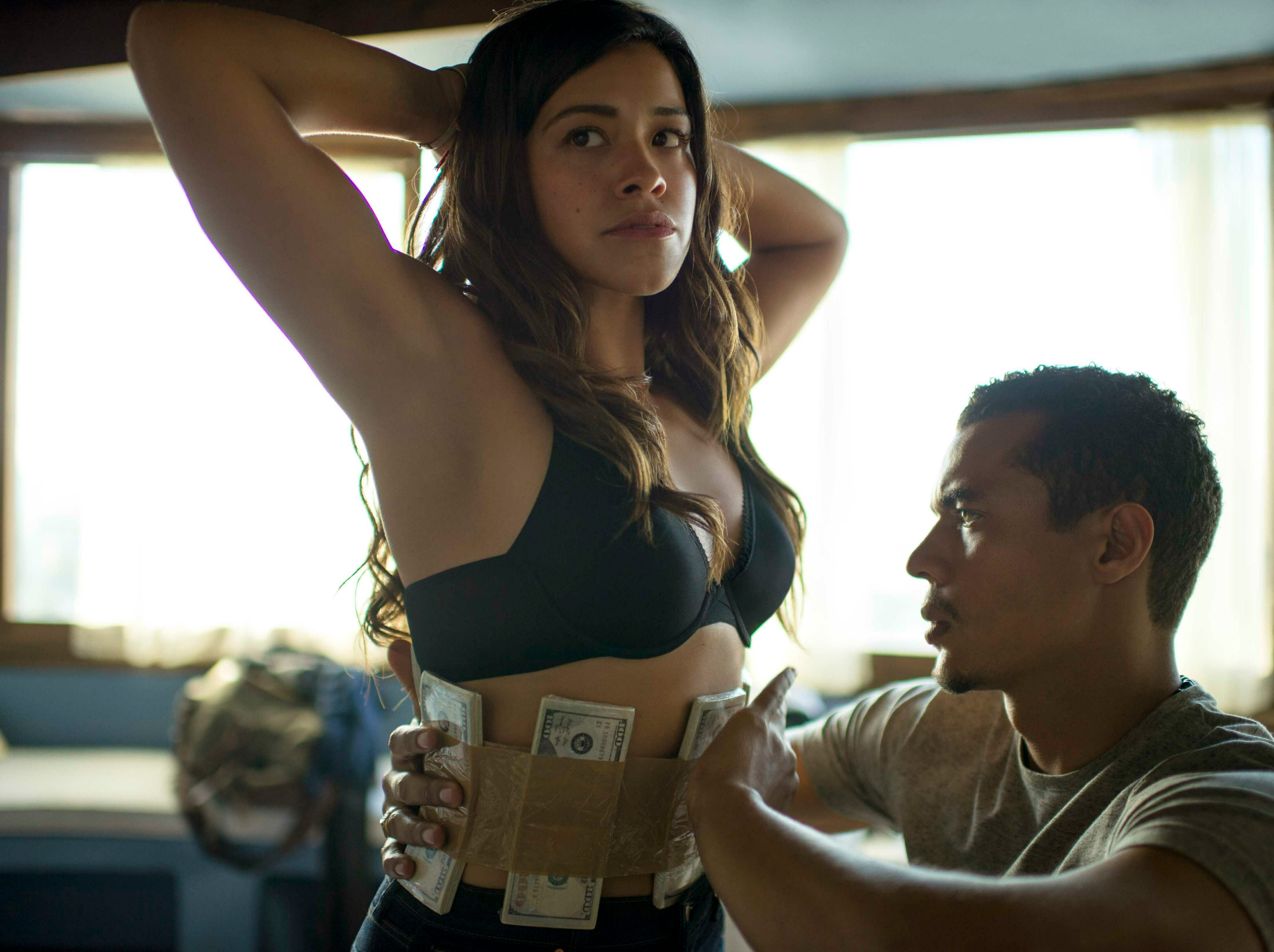 """This image released by Sony Pictures shows Gina Rodriguez, left, and Ismael Cruz in a scene from """"Miss Bala."""""""
