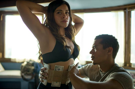 "This image released by Sony Pictures shows Gina Rodri­guez, left, and Ismael Cruz in a scene from ""Miss Bala."""