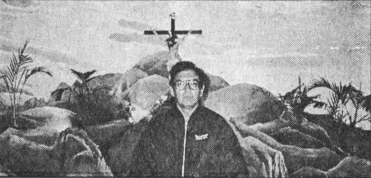 The Rev. Sam Garcia stands in front of a mural at San Martin de Porres Catholic Church in 1989.