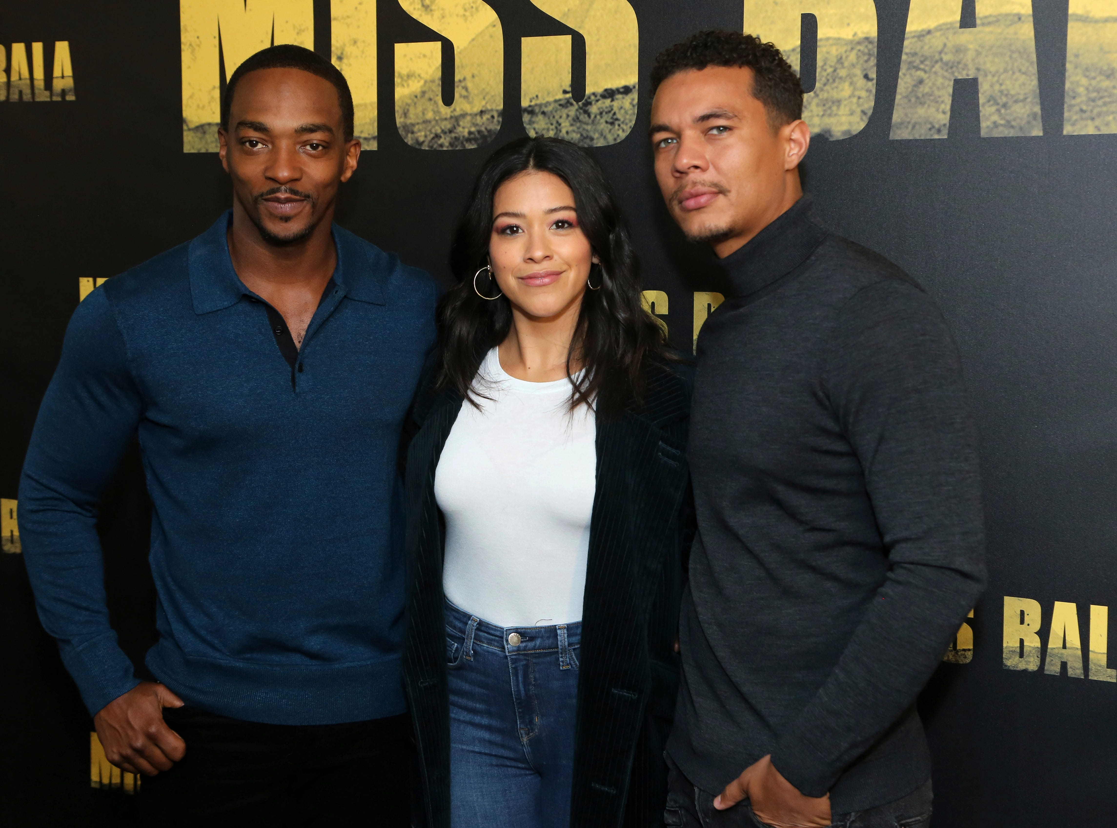 """Anthony Mackie, from left, Gina Rodriguez and Ismael Cruz Cordova, members of the cast pose for a photo at the """"Miss Bala"""" Photo Call at The London West Hollywood on Sunday, Jan. 13, 2019, in West Hollywood, Calif."""