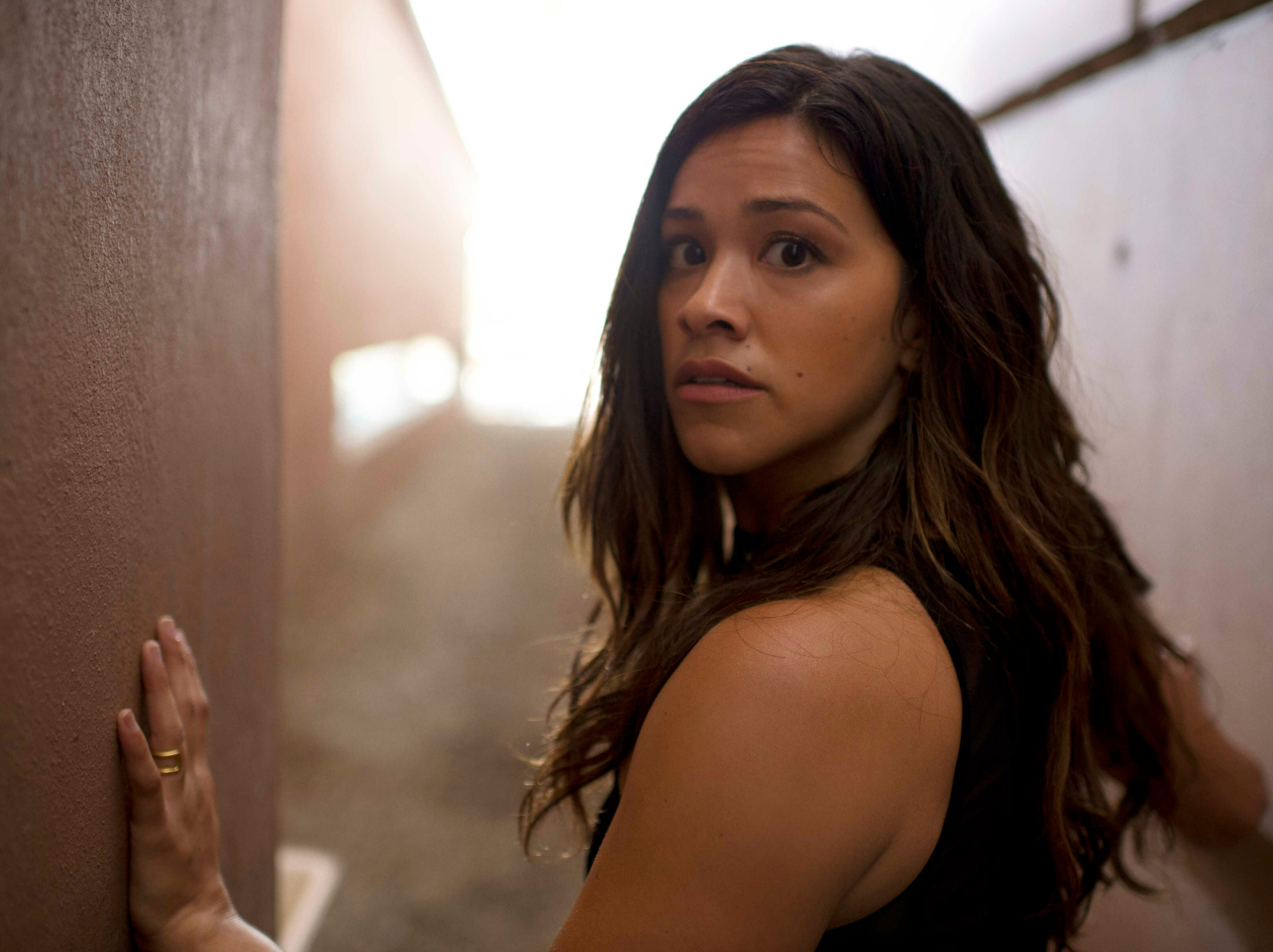 """This image released by Sony Pictures shows Gina Rodriguez in a scene from """"Miss Bala."""""""
