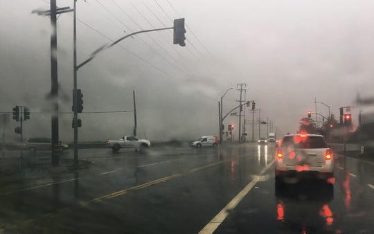 Rain strikes a windshield near Oxnard as a storm passes through Ventura County on Thursday.