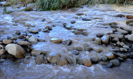 Water surges over rocks in this photograph of a section of the Ventura River, north of Ventura.