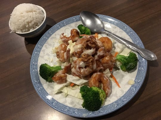 Dishes by Hong Kong Inn chef and owner Ken Chen include crispy walnut shrimp.