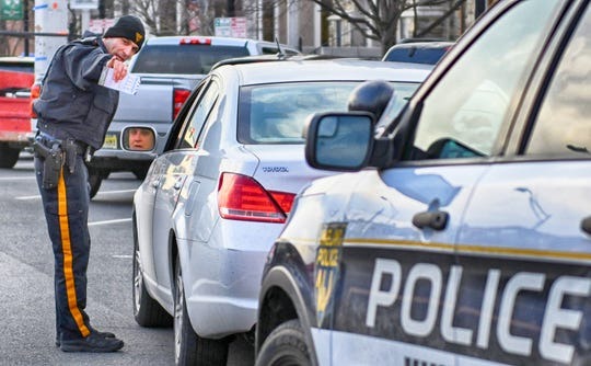 Vineland Police Officer Luis Rivera shared safety information with driver who reportedly failed to stop for a pedestrian in a marked crosswalk along Landis Avenue on Wednesday, Jan. 30, 2019.