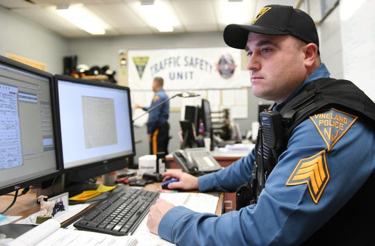 Vineland Police Sgt. Nick Dounoulis looks at a crash investigation report in the department's Traffic Safety Unit office room on Wednesday, Jan. 30, 2019.