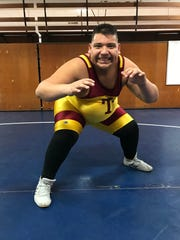Tulare Union's Adam Alcaraz is a member and honorary coach on the Tribe wrestling team.