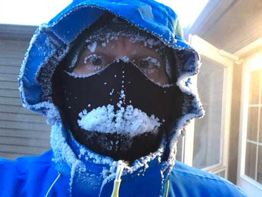 This is what I look like after jogging two miles in a wind chill of 44 degrees below zero.