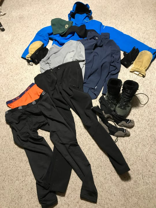 The stuff I wore for a 2-mile run Thursday morning: Wool socks, Salamon winter hiking boots (not bad for jogging), boxer briefs, tights, Nordic ski pants, long sleeve technical shirt, long sleeve fleece shirt, downhill ski coat with hood, glove liners, leather snowboarding mittens, face mask, fleece Packers hat.