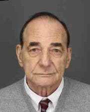 Philip Budin, of New York City, was charged with six felonies in connection with a violent home invasion in Chappaqua.