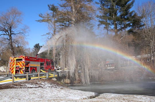 With no fire hydrants in the area Goldens Bridge firefighters had to draft water from a nearby pond as they in battle a house fire on Nash Road in Goldens Bridge Jan. 31, 2019.