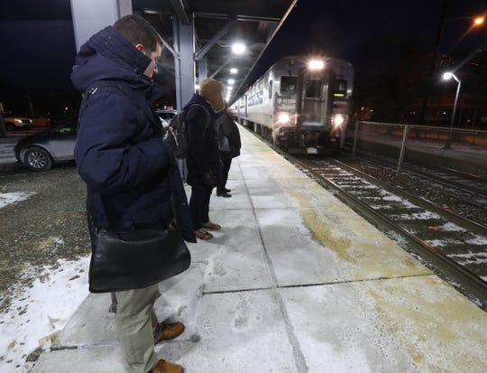 Commuters on the platform prepare to board their morning train at the Suffern NJ Transit Station in Suffern on Thursday, January 31, 2019.