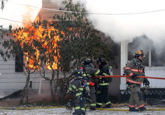 Firefighters from several northern Westchester and Putnam county fire departments assist Goldens Bridge firefighters in battling a house fire on Nash Road in Goldens Bridge Thursday, Jan. 31, 2019. Firefighters had to work in single-digit temperatures while battling the blaze.