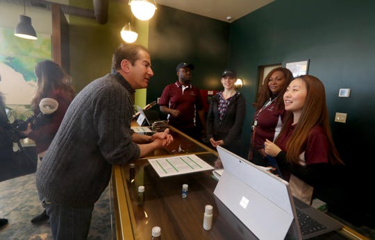 Stephen Ashekian, Chief Operating Officer of Remedy, a new medical marijuana dispensary in Bardonia, speaks with employees during the dispensary's grand opening Jan. 31, 2019. The dispensary is the first medical marijuana site to open in Rockland County.