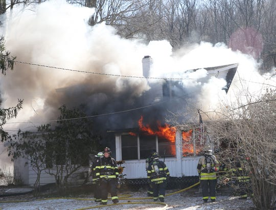 Firefighters from several northern Westchester and Putnam county fire departments assist Goldens Bridge firefighters in battling a house fire on Nash Road in Goldens Bridge Thursday, Jan. 31, 2019.