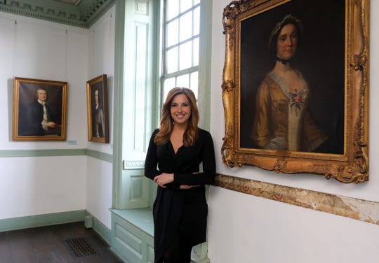 "Journalist Mary Calvi has written a new book, called ""Dear George, Dear Mary: A Novel of George Washington's First Love"" as she stands next to a portrait of Mary Philipse, in one of the rooms at Philipse Manor Hall in Yonkers, pictured Jan. 31, 2019."