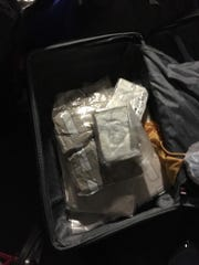 Authorities said they found heroin and fentanyl in this suitcase at the Monarch building in Ridge Hill in Yonkers, where suspected drug ring leader Juan Silva Santos lived.