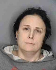 Mirabai Sheridan, of the Bronx, is facing five felonies and two misdemeanors in connection with a violent home invasion in Chappaqua.