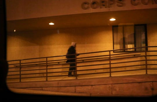 A man heads into the Salvation Army shelter after being given a lift and answering survey questions offered by volunteers taking a count of the area's homeless Wednesday night.